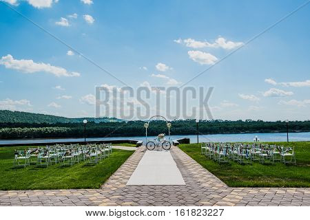 White wooden chair on wedding registration outdoors