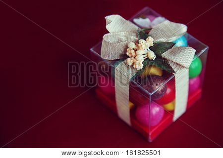 Gift box with chocolates on a red background