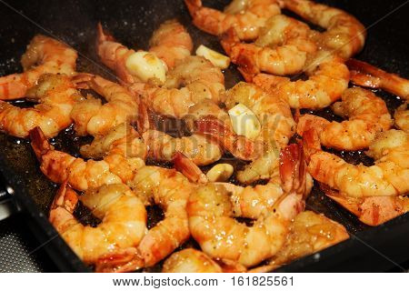 Shrimps with garlic. King size shrimps on a grill