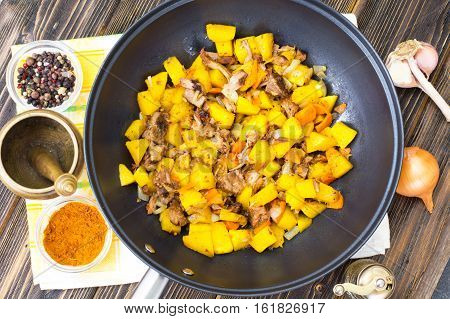 Stewed vegetables with meat in a frying pan. Studio Photo