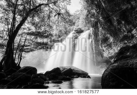 Waterfall cave Haewsuwat waterfall at Khao Yai National Park Thailand on sunset.