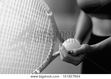 Player's hand with tennis ball preparing to serve in tennis cort. serving tennis, playing tennis, tennis sport, tennis ball in hand woman, tennis racket in hand woman