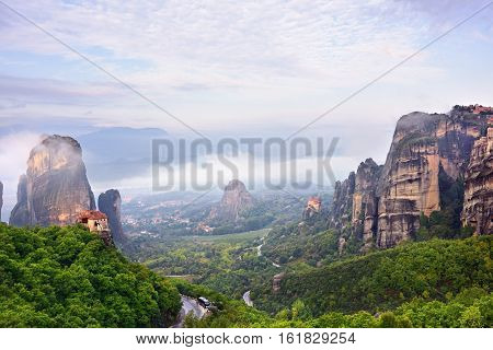 Meteora monasteries. Beautiful landscape and view on the Holy Monastery of Roussanov placed on the edge of high rock before sunset. Kastraki Greece
