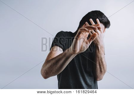 Man Trying To Protect Himself With His Arms