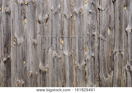 Closeup of natural unpainted rough wooden boards background