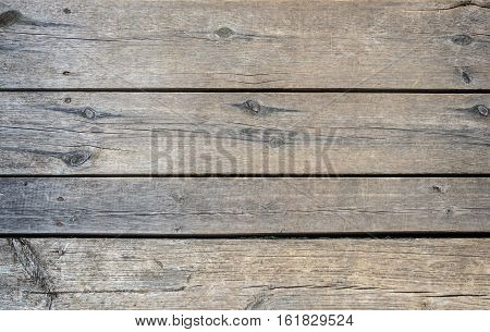 Texture of an old unpainted wooden boards
