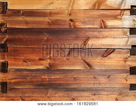 Texture of old wooden wall made of timber jointed