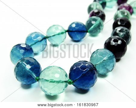 fluorite gemstone beads isolated on white background