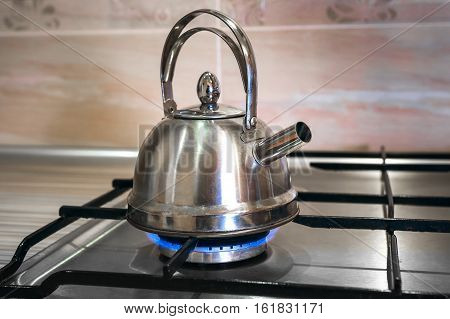 steel kettle on a gas stove home cooking boil water for tea