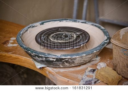 An empty circle, where the potter molds product. Creative studio potter. Workplace wizard Crock pottery