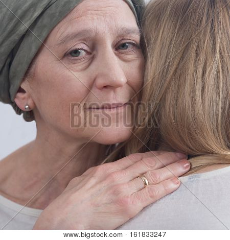 Cancer Woman Hugging Young Girl