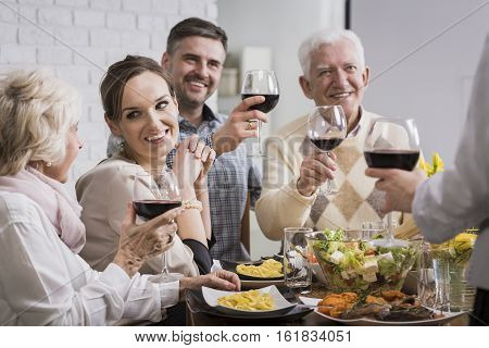 Joyful Family Celebrating Dinner