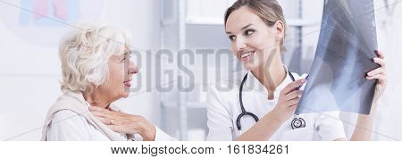 Relieved Woman Talking To Doctor