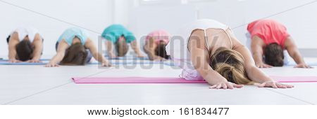 Young People Stretching In A Gym
