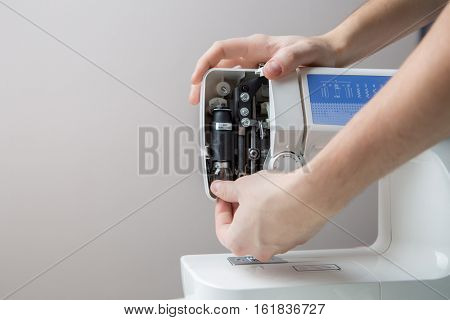 Sewing machine on blank background