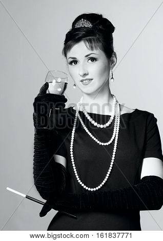 Portrait Of A Beautiful Young Woman In Retro Style With Cigarette In Mouthpiece