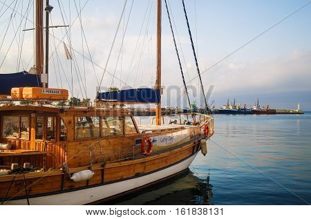 Nesebar Bulgaria - September 05 2014: Pleasure yacht in the port of the old town of Nessebar. Black Sea coast. Wooden sailing ship. Sunny summer day.