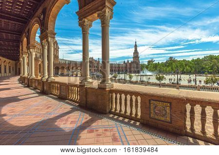 The famous Square of Spain, in Spanish Plaza de Espana, view from the path with columns. Seville, Andalusia, Spain.