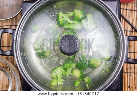 Broccoli boiling in a pan / cooking spicy spaghetti concept