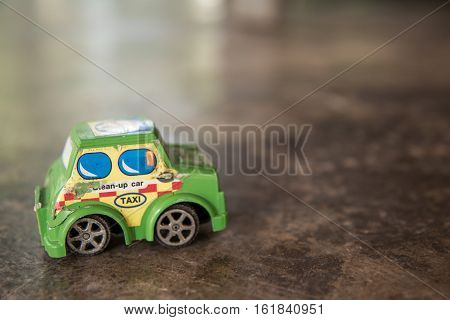 Old toy car vintage tone on the concrete floor