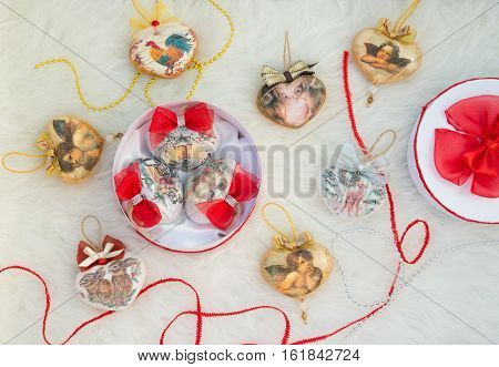 Christmas toy heart bowknot and ornament on light background