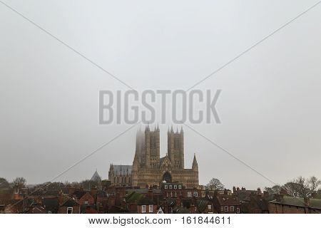 LINCOLN ENGLAND - DECEMBER 15: Wide view of Lincoln Cathedral in the fog. In Lincoln England. On 15th December 2016.