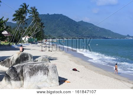 tourists relaxing on the popular lamai beach ko samui island thailand