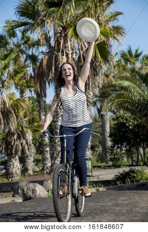 Cheerful Female Cycling On Holiday In Spain