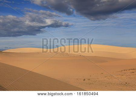 Stunning landscape of sand dunes on the background of blue sky near Mui Ne place Vietnam