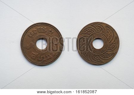 Old coin Thailand which is obsolete today on white background 1 baht