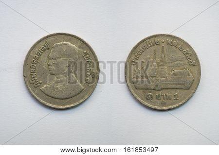 Old Thai coin on white background 1 baht B.E. 2525