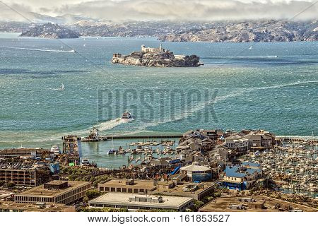 San Francisco, California, United States - August 14, 2016: Aerial view of Port of San Francisco, Alcatraz Island and Fisherman's Wharf from top of Coit Tower.