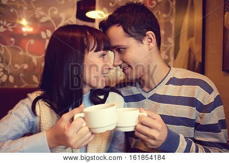 man and woman sitting in a cafe. young couple in love. Valentines Day