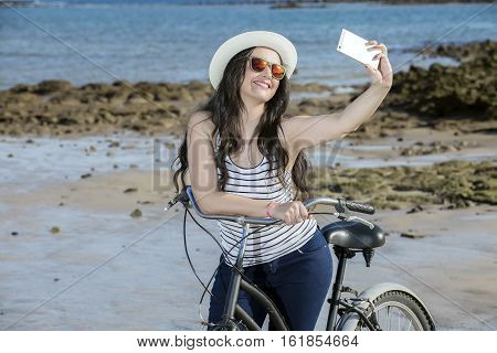 Young Woman With Bike Selfie