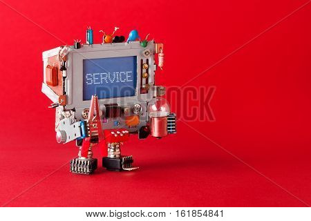 Service center and repairing concept. Tv robot handyman with pliers and light bulb in hands. Warning message service on blue screen monitor head. red background copy space