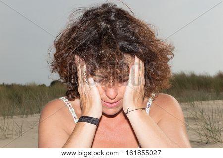Woman In Outdoor Beach Headache Or Migraine
