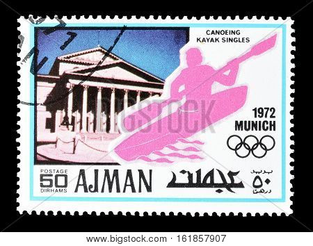 AJMAN - CIRCA 1971 : Cancelled postage stamp printed by Ajman, that shows Canoeing.