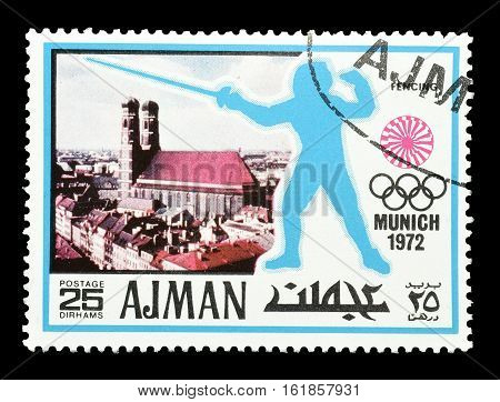 AJMAN - CIRCA 1971 : Cancelled postage stamp printed by Ajman, that shows Fencing.