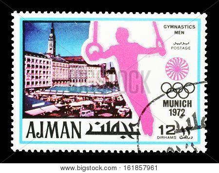 AJMAN - CIRCA 1971 : Cancelled postage stamp printed by Ajman, that shows Gymnastics.