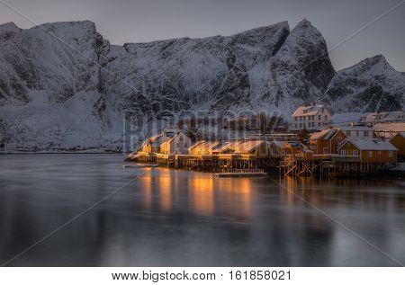 Last flash of sunlight on rorbu in Reine Norway
