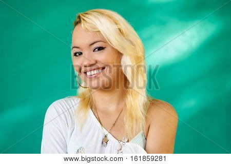 Cuban people and emotions portrait of beautiful latina girl laughing and looking at camera. Happy hispanic young woman from Havana Cuba smiling