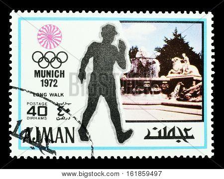AJMAN - CIRCA 1971 : Cancelled postage stamp printed by Ajman, that shows Long distance walking.