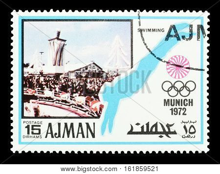AJMAN - CIRCA 1971 : Cancelled postage stamp printed by Ajman, that shows Swimming.