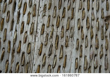 Old threshing board for wheat of wood and stones texture pattern