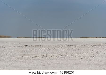 salt dry lake bed mirage on the horizon on a sunny day