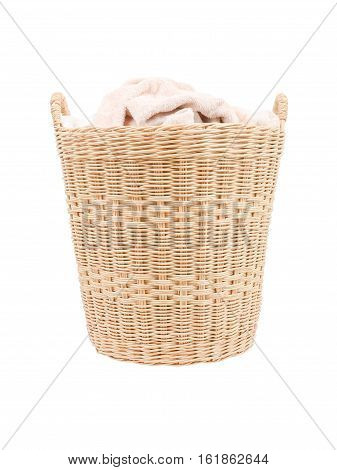 towels in basket isolated on white background