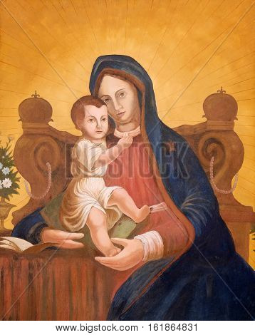 ZAGREB, CROATIA - JULY 16: Virgin Mary with baby Jesus, painting on house fasade in Zagreb, Croatia on July 16, 2015.