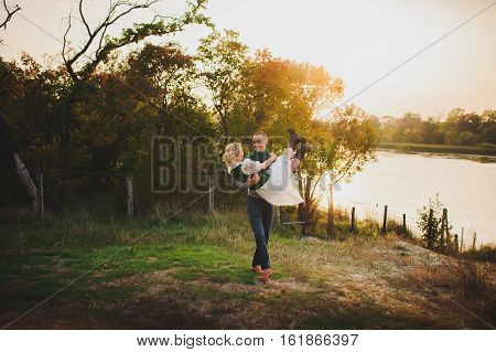 the man picked up the woman in the forest at sunset