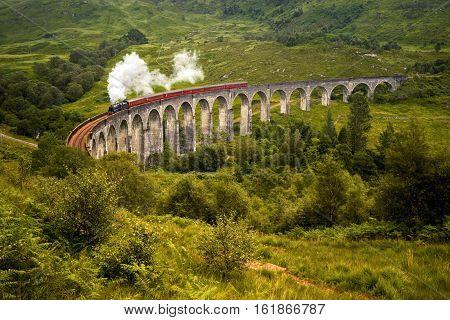 Steam train on Glenfinnan bridge Highlands Scotland