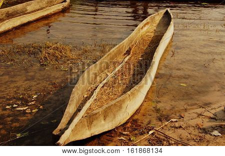a middle african wood mokoro in the Okavango Delta with a special stick to pus on shallow water